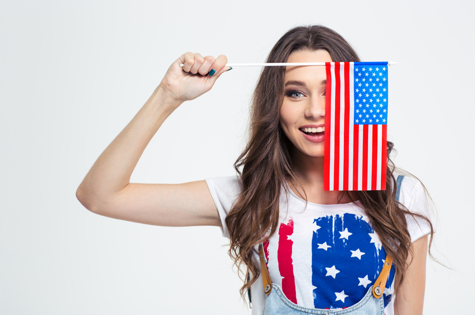 Happy Woman Holding American Flag