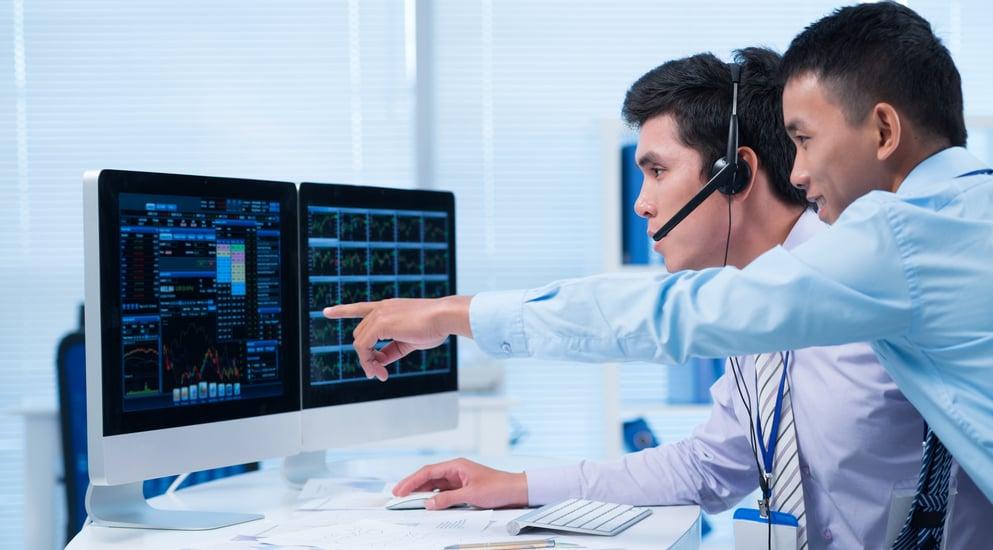 Investors at a computer