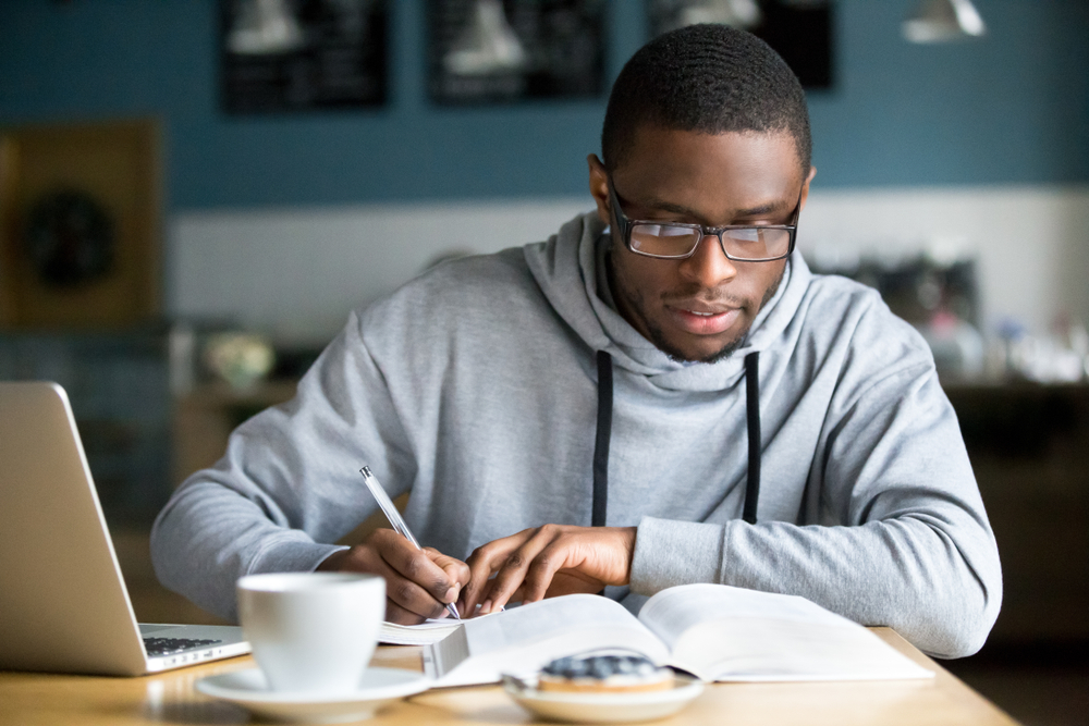 Student Studying at Cafeteria