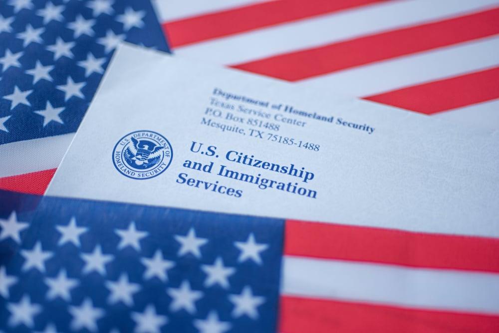 visa paperwork on American flag
