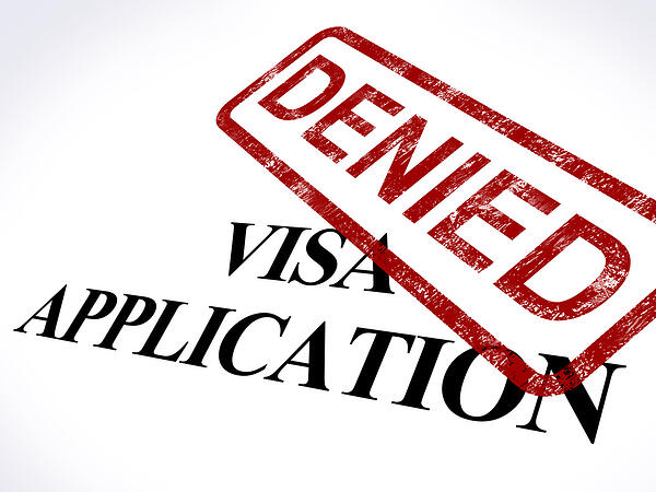 Visa application with denial stamp