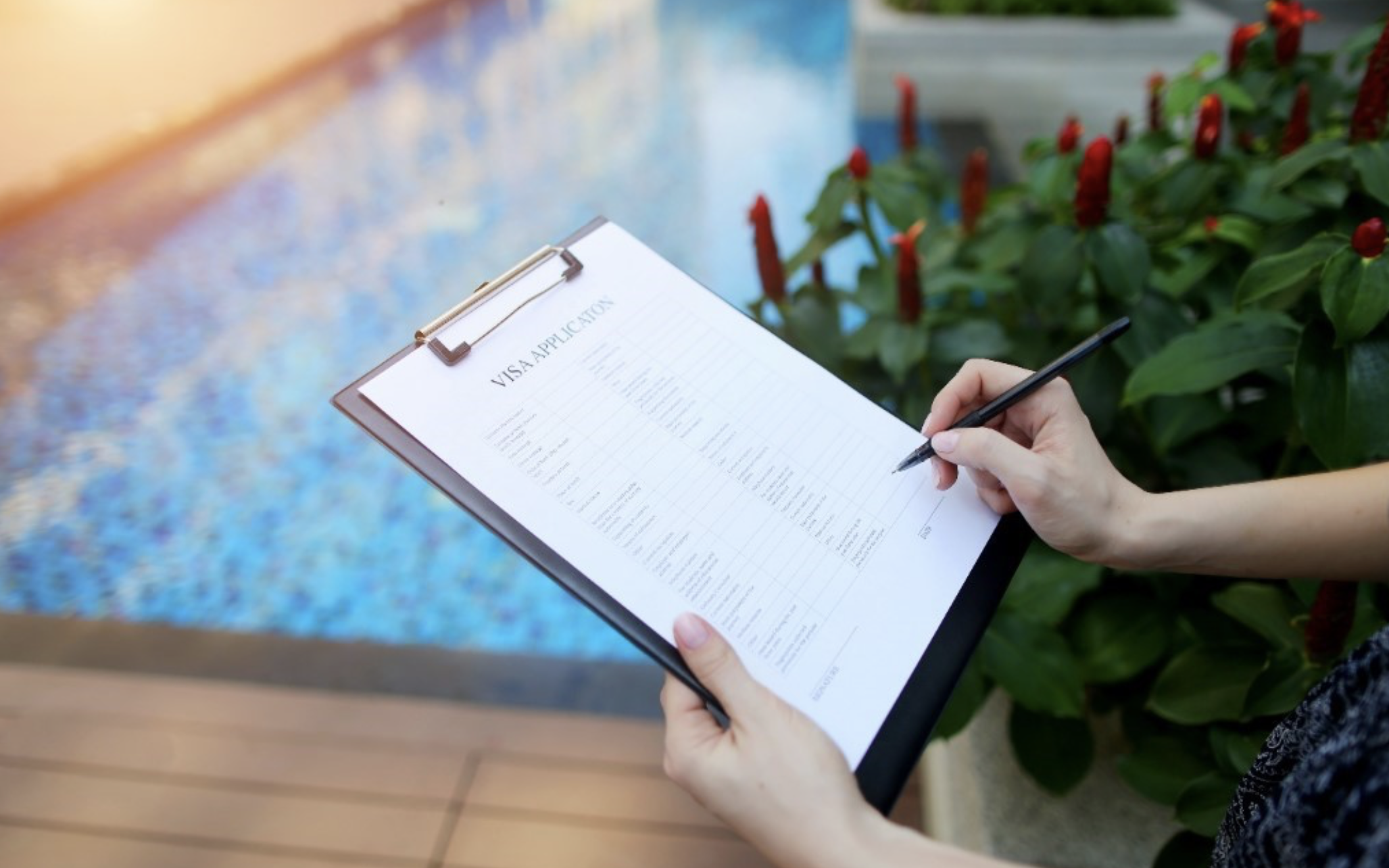 Woman holding a checklist by the pool