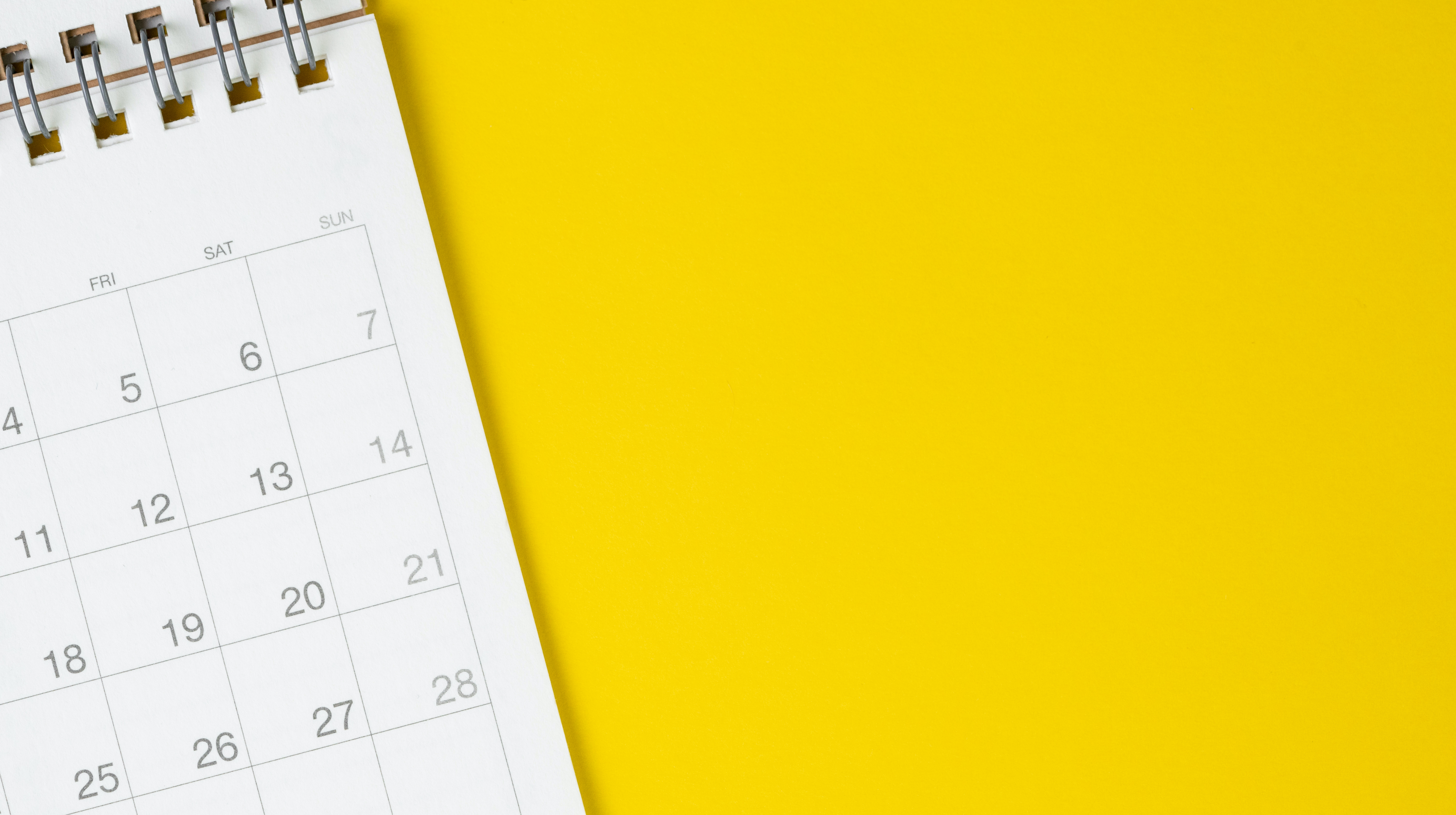 calendar on clean yellow background